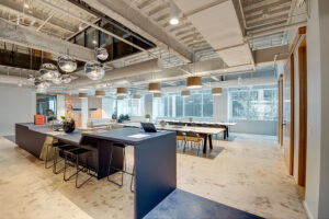 St. Paul Place - Central Office with multiple tables and a standing desk area
